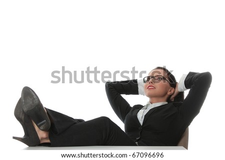 Young beautiful business woman having a rest at the working place.
