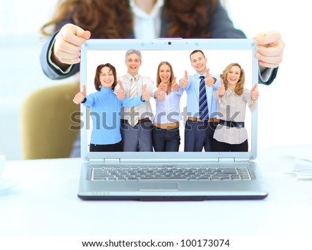 Young beautiful business woman , point finger at isolated white laptop screen over white background, business team