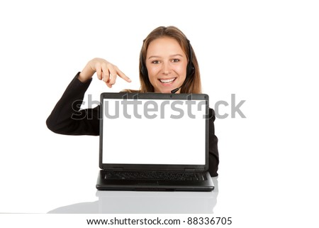 Young beautiful business woman smile sitting at the desk looking at camera, point finger at isolated white laptop screen over white background