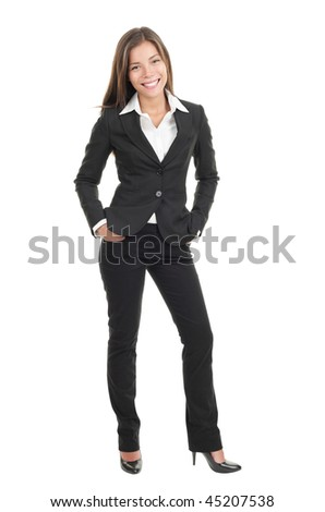 Young beautiful businesswoman isolated. Stylish mixed caucasian / chinese model in suit isolated in full length on white background.