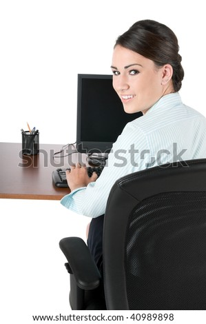 Young, beautiful businesswoman typing on computer keyboard at work, happy and smiling, isolated on white background