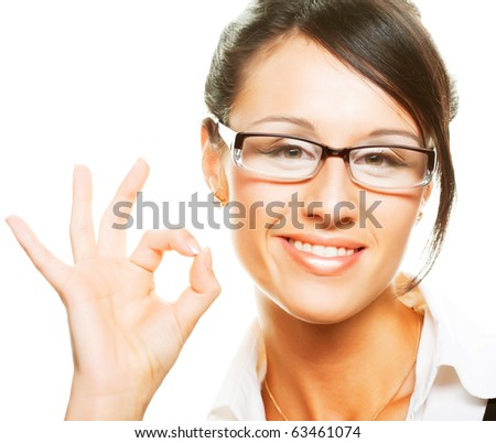 Young beautiful businesswoman wearing glasses. Isolated over white.