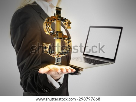 Young  beautiful Businesswoman with laptop and dollar money sign in hand on gray background