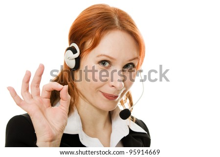 Young beautiful call center female operator shows okay gesture isolated on white