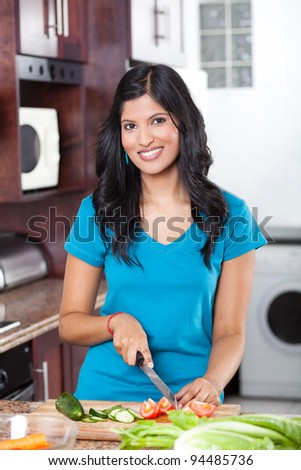 young beautiful casual woman cooking in kitchen