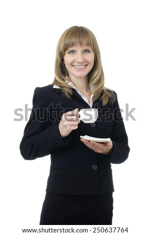 Young beautiful Caucasian business woman with blue eyes waist up studio shot on white background (isolated). Looking at camera and smiling. Holding a cup of coffee on a saucer.