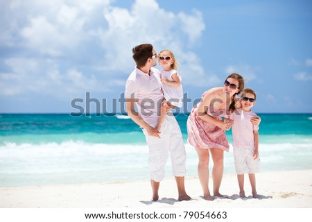 Young beautiful Caucasian family on Caribbean beach vacation