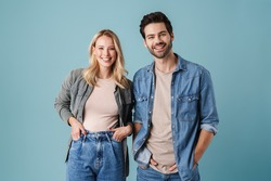 Young beautiful caucasian man and woman smiling and posing at camera isolated over blue background