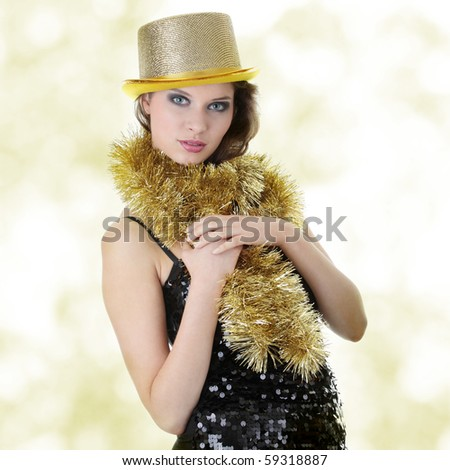 Young beautiful caucasian woman in black elegant party dress and gold hat