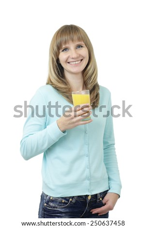 Young beautiful Caucasian woman with blue eyes waist up studio shot on white background (isolated). Looking at camera and smiling. Holding a glass of orange juice.