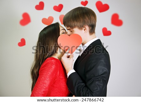 Young beautiful couple in love tenderly kissing  #247866742
