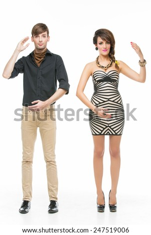 Young beautiful couple looking like dolls standing over white background Stock photo ©
