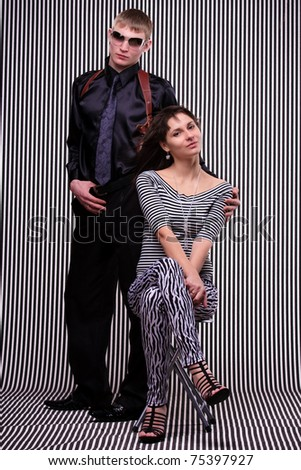 Young beautiful couple over stripe background
