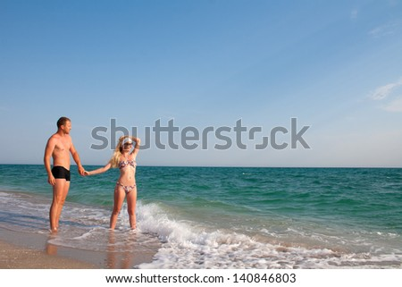 Young beautiful couple relaxing on the beach
