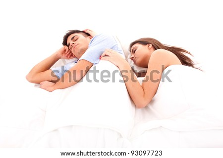 Young beautiful couple sleeping together in bed