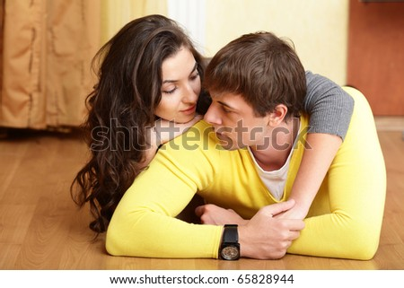 Young beautiful couple tender hugging at home #65828944