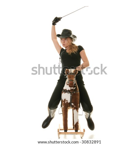 Young beautiful cowgirl (jockey) race on hobbyhorse with face expression isolated on white background (race concept).