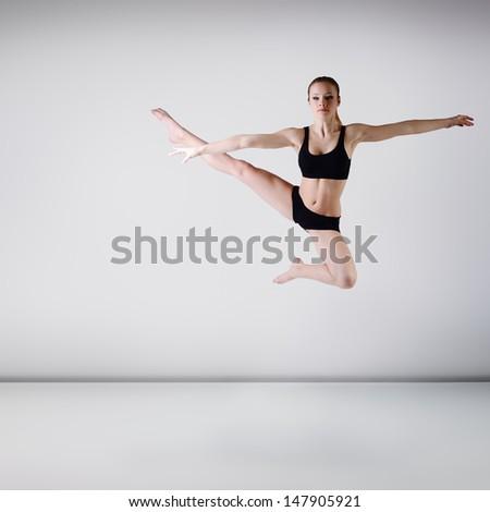 young beautiful dancer girl dancing and jumping, studio series