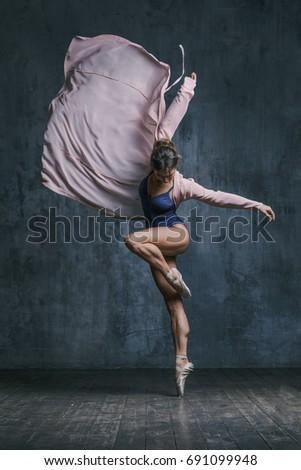 Young beautiful dancer is posing in studio #691099948