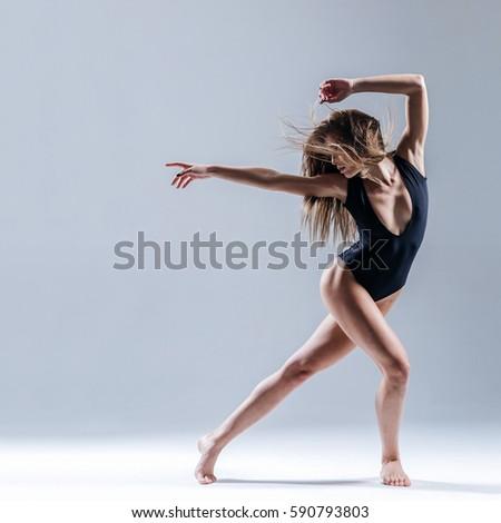 Young beautiful dancer posing in studio #590793803