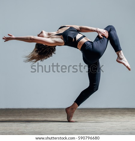 Young beautiful dancer posing in studio #590796680