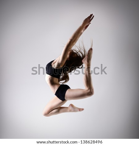 young beautiful dancer teen girl dancing and jumping studio series