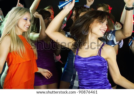 Young beautiful dancing woman at disco
