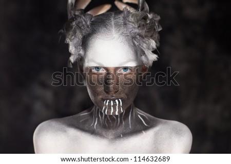 Young beautiful fashion model with creative makeup close-up portrai.Halloween