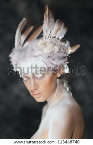 Young beautiful fashion model with creative makeup close-up portrai.White Swan, the ballet.Halloween