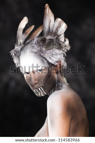 Young beautiful fashion model with creative makeup close-up portrait.Halloween