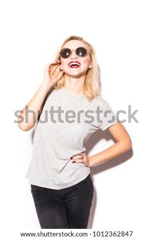 Young beautiful fashion woman with sunglasses on a white background #1012362847