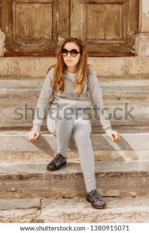 Young Woman Sitting On Steps Of Building Images And Stock