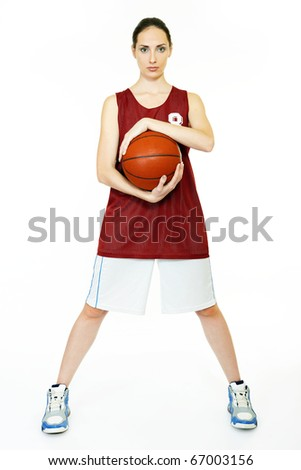 Young beautiful female basket ball player