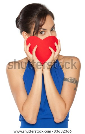 Young beautiful female in blue dress peeking from the heart shape isolated on white background