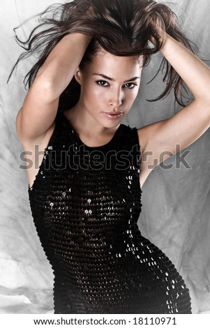 young beautiful female model with long flying hair, studio shot