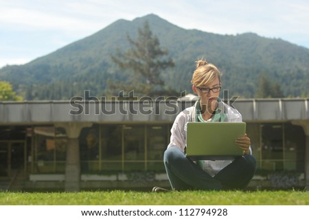 Young beautiful female student on campus