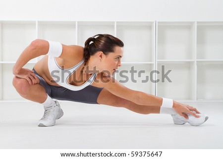 young beautiful fitness woman stretching, studio shots