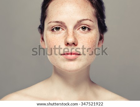 Young beautiful freckles woman face portrait with healthy skin - Shutterstock ID 347521922