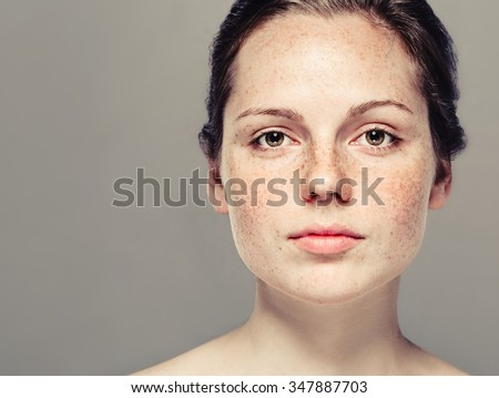 Young beautiful freckles woman face portrait with healthy skin - Shutterstock ID 347887703