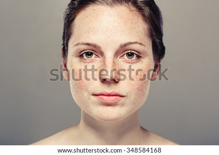 Young beautiful freckles woman face portrait with healthy skin - Shutterstock ID 348584168