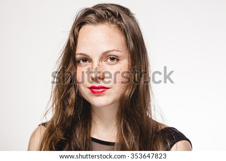 Young beautiful freckles woman face portrait with healthy skin #353647823