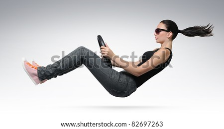Young beautiful girl driver in sunglasses with a wheel, concept