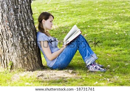 Young beautiful girl enjoying a book