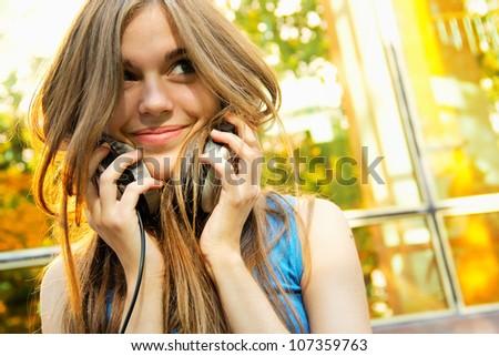 Young beautiful girl happy with headphones