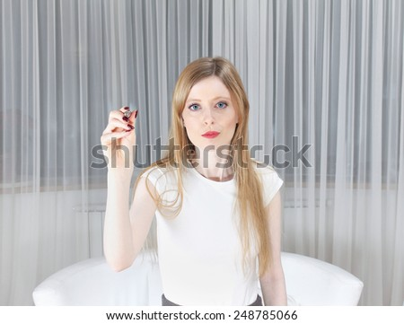 Young beautiful girl holding pen in her right hand going to write