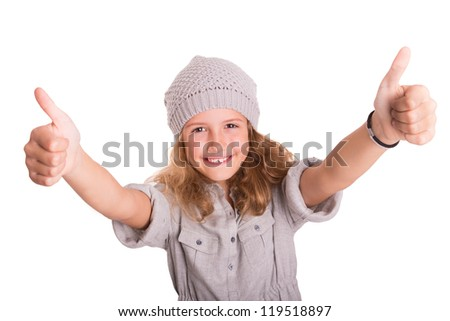 Young beautiful girl holding thumbs up and looking into the camera