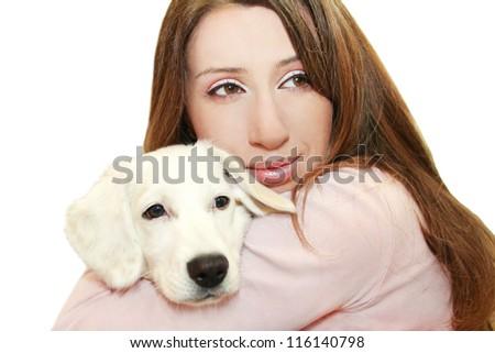 Young, beautiful girl hugging white puppy.