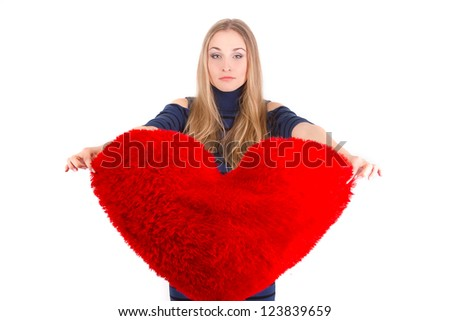 Young beautiful  girl  hugs a big soft heart. Feast of St. Valentine's Day. - stock photo