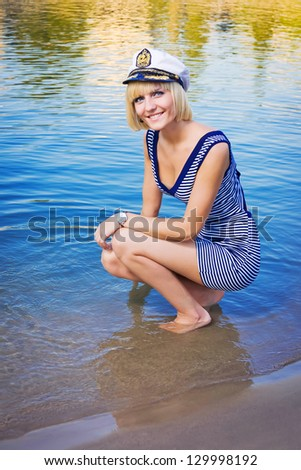 Young beautiful girl immersed in water