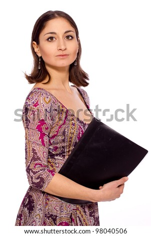 young beautiful girl in a beautiful dress keeps a file of documents - stock photo